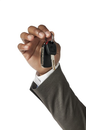 Business hand holding key in a close-up image Stock Photo - 17141650