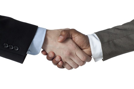 Image of business partners shaking hands together against white background