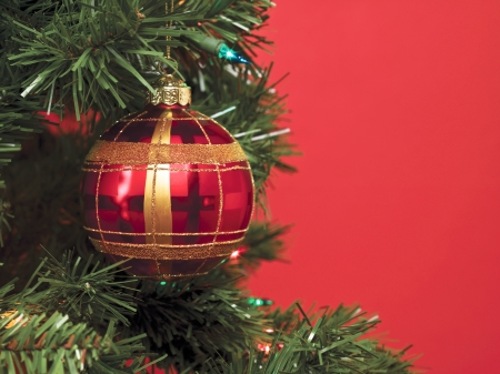 A close-up image of Christmas ball over the Christmas tree isolated on a red background Stock Photo - 17148467