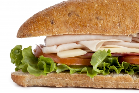 cropped image: Close-up cropped image of homemade turkey sandwich isolated on a white background Stock Photo