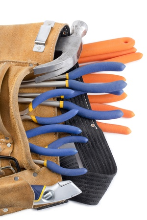 Close-up cropped shot of tool belt on white background. Imagens