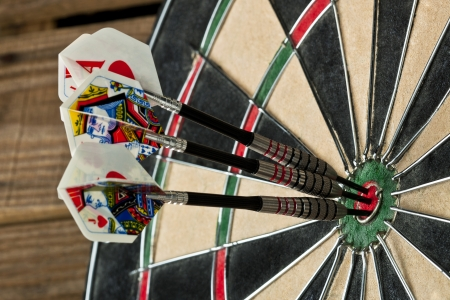 cropped image: A close-up cropped image of the dart board with a bulls eye pin at the center Stock Photo