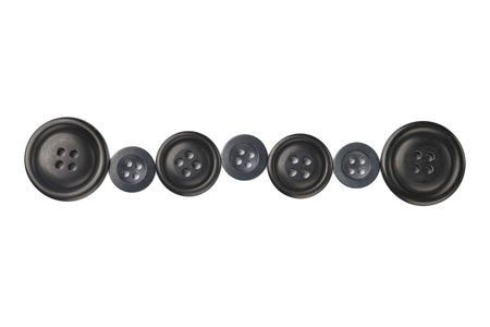 Close up image of different sizes of black cloth buttons against white background Stock Photo - 17140406