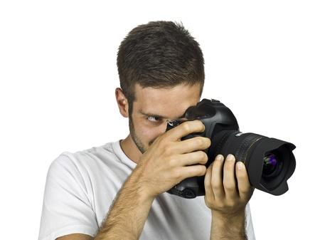 Photographer adjusting lens to focus camera. photo