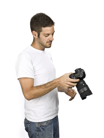Male checking camera with right hand. photo