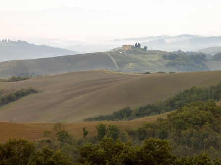 Serene overlook of rolling hills and Tuscan villa in the background. Stock Photo - 17150029