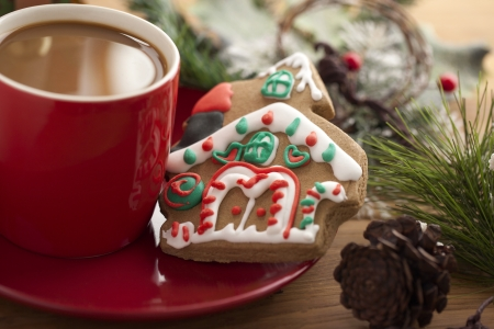 Gingerbread house and coffee on the saucer photo