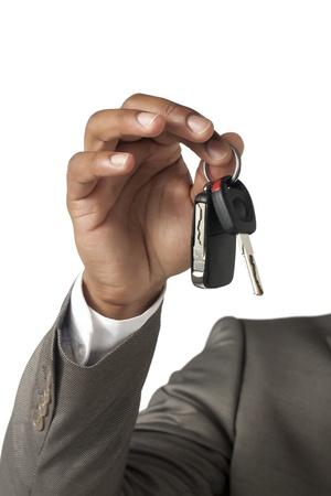 Close up image of businessman hand holding key against white background Stock Photo - 17143153