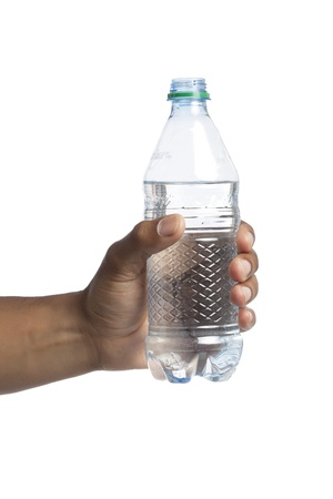 Human hand holding a bottle of water over a white background photo