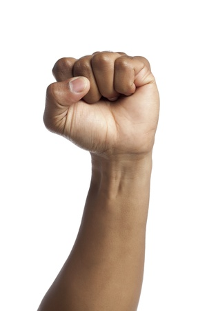 closed fist sign: Close-up image of human hand with closed fists against the white surface