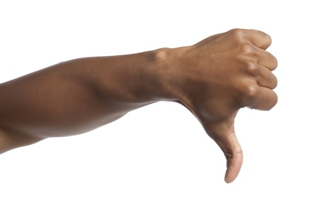 Close-up image of human hand with thumbs down against the white surface Stock Photo - 17141614