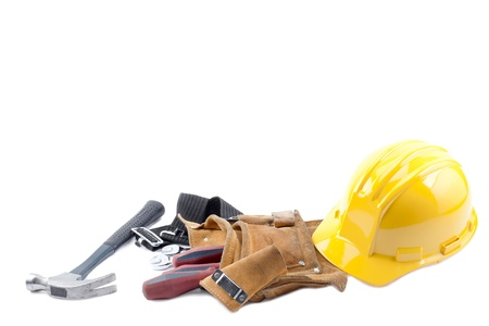 objec: Hardhat, hammer, tool belt and screw driver on a white background