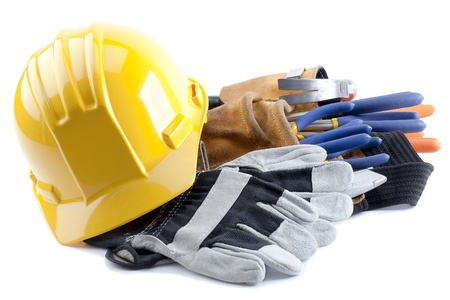 Hard hat and gloves with construction tool belt and carpentry tools inside photo