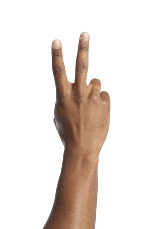Close-up image of human hand with peace sign against the white surface Stock Photo - 17141632
