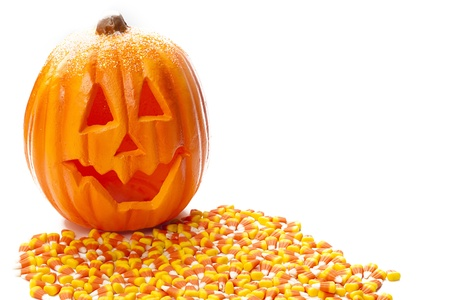 candy corn: Jack o lantern with candy corn infornt of it. Stock Photo