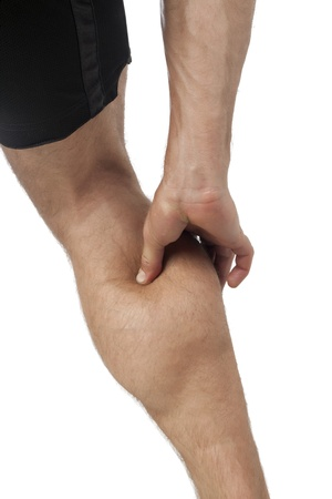 calf strain: Close up image of leg calf injury against white background