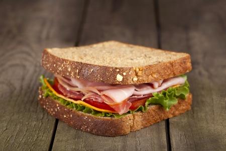 Organic whole wheat bread b.l.t sandwich in a close-up image
