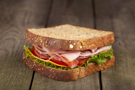 turkey bacon: Organic whole wheat bread b.l.t sandwich in a close-up image