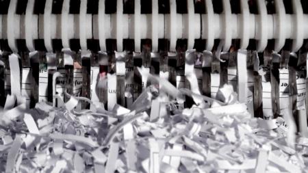 Paper shredder with shredded paper in a macro image Stockfoto