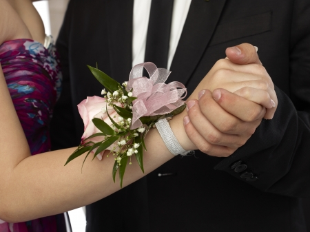 Close up image of pink corsage in a woman wrist Foto de archivo