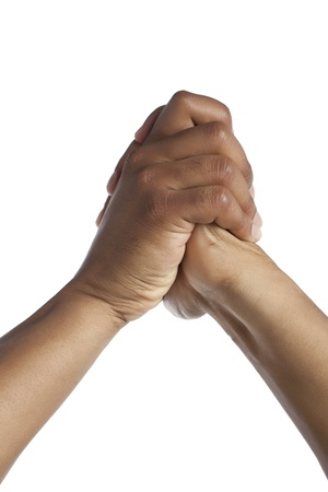 Close-up image of human hand with a praying gesture isolated on a white surface photo