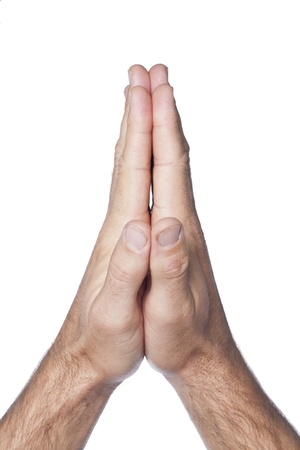 Close up image of praying hands of a man against white background Stock Photo - 17141494