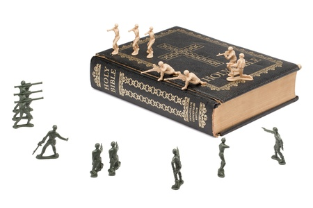 Troop of soldiers fighting for a bible