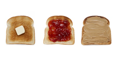 Three bread toast with butter, jam and peanut butter spread displayed on white background. photo