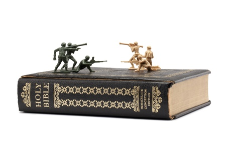 Image of toy soldiers fighting on Holy bible