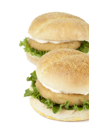 Cropped image of two chicken hamburgers isolated on a white background photo