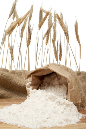 Spilled sack of flour and wheat ears Stock Photo - 17152868