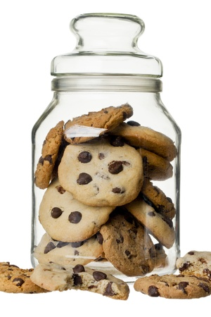 Glass jar with cookie on a white background photo