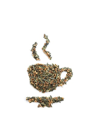 Close-up shot of dried tea leaves forming tea cup on white background. photo