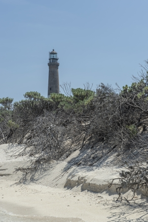 Distance view of a lighthouse in Dry Tortugas, Florida photo