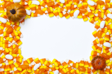 Close-up shot of arrangement of candy corns and pumpkins. Stock Photo - 17153179