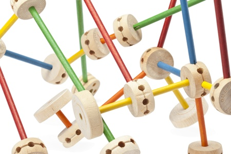 tinker: Close up image of wooden tinker toys against white background Stock Photo