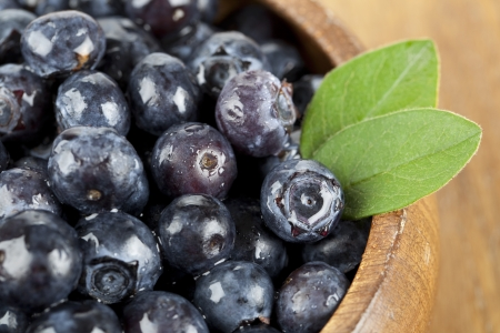 Close up image of blueberries in wooden bowl Zdjęcie Seryjne