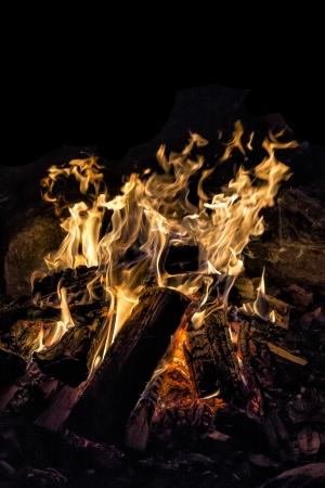 engulfed: Burning embers on a bonfire in Haliburton
