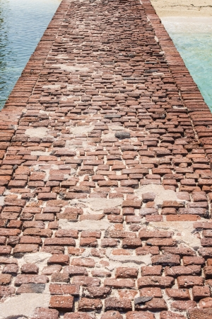 fort jefferson: Close-up image of a brick bridge at the pier in Dry Tortugas Stock Photo