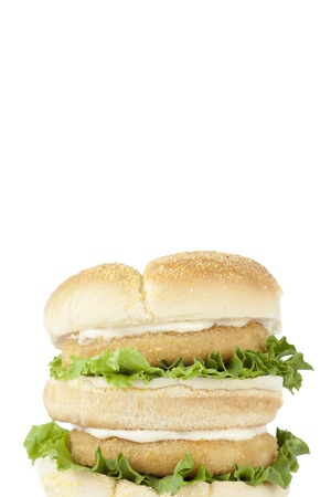 Close-up image of burger with crispy chicken and vegetables isolated on a white background photo