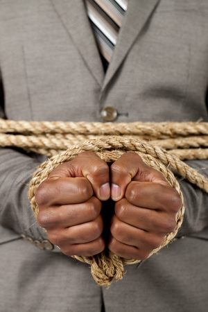 Business hands tied with rope stock photo Stock Photo - 17168660