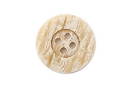 Close up image of button made of ivory against white background Stock Photo - 17150902
