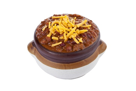 Chili con carne with grated cheese toppings on a clay pot photo