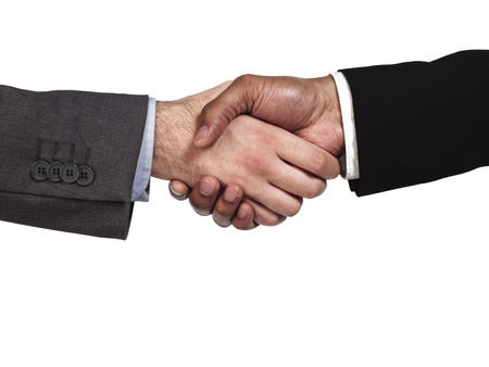 Close-up of business colleagues shaking hands on white background, Model: Kareem Duhaney photo