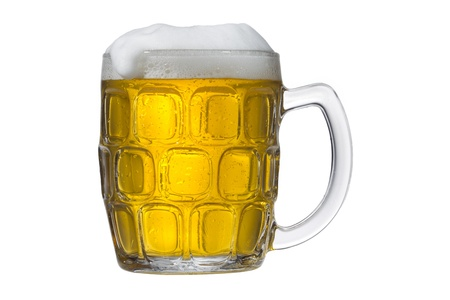 detailed shot: Detailed shot of a beer mug filled with beer against white background. Stock Photo