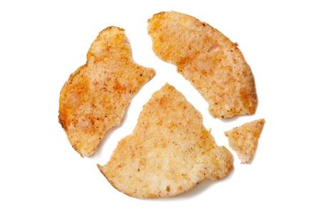 crack: Close up image of crispy potato cheese chip against white background Stock Photo
