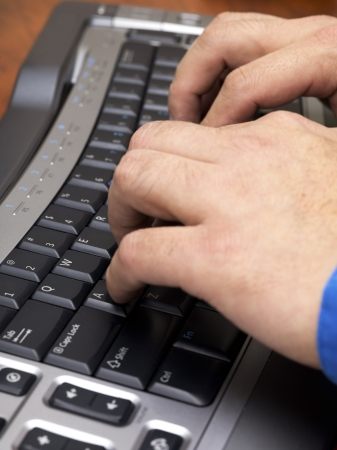 Close-up cropped image of human hands typing on black keyboard. Stock Photo - 17152564