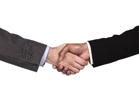 Cropped image of business people shaking hands on white background, Model: Kareem Duhaney photo