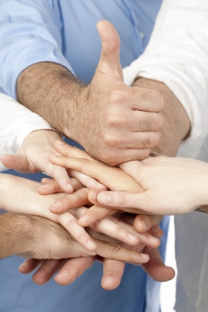 Diverse group of people with their hands together with a thumb up on top Stock Photo - 17167477