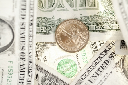 Close-up shot of one dollar coin and U.S. banknote. Stock Photo - 17168770